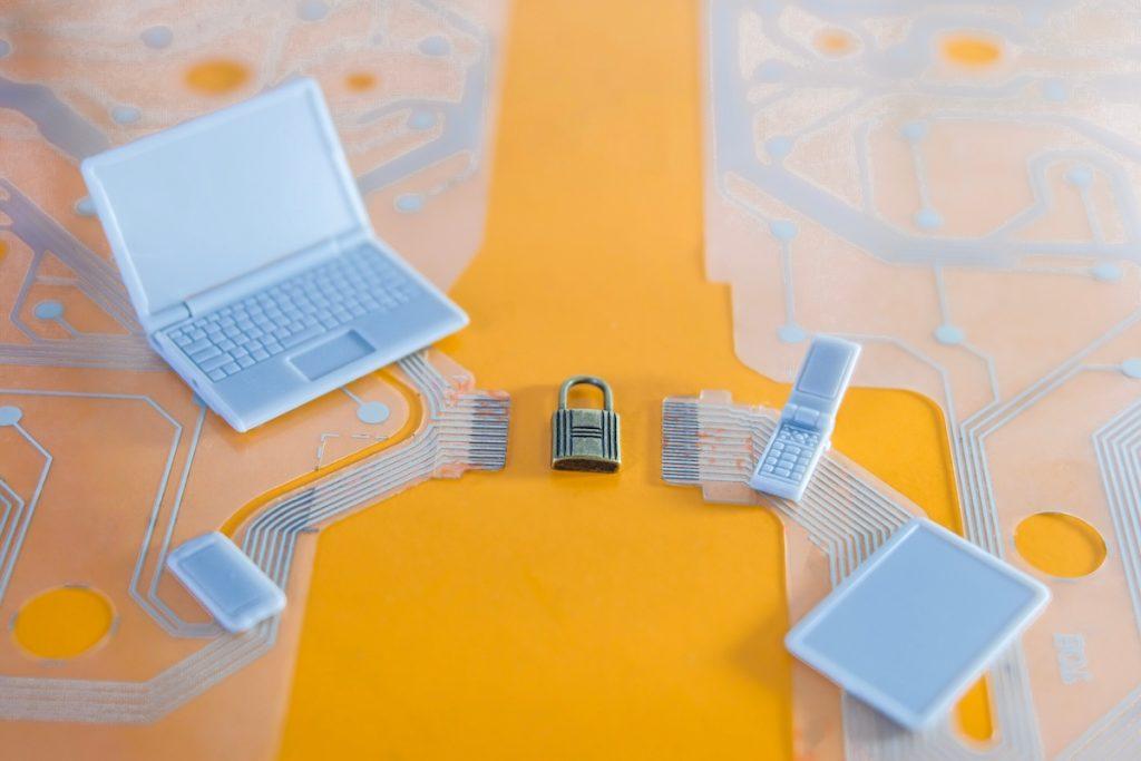 electronic devices surrounding padlock